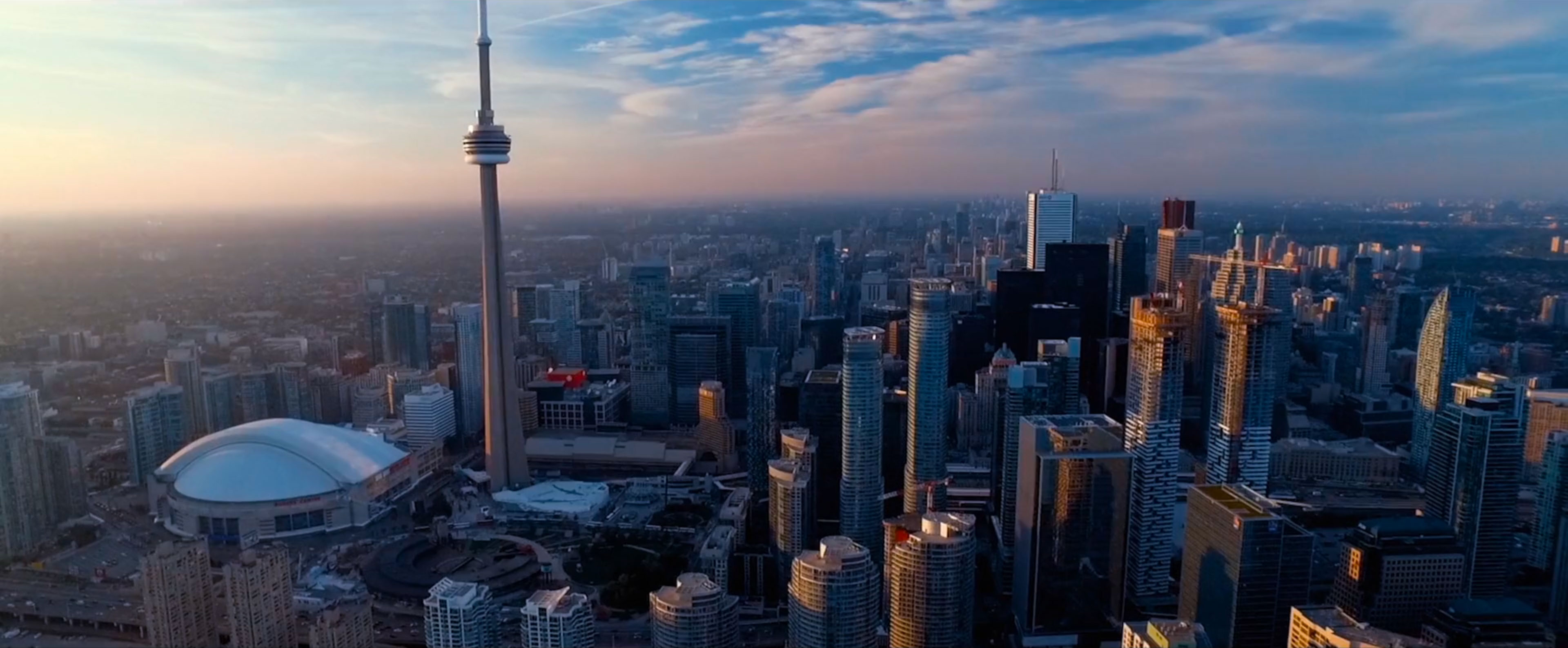 Early morning skyline view of downtown Toronto, featuring the CN Tower.