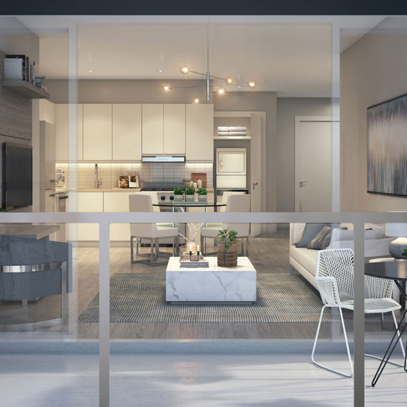 Suite interior viewed from outside floor-to-ceiling windows featuring a contemporary grey living room and a brightly lit kitchen.