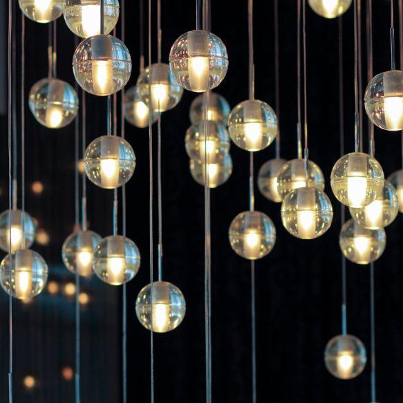 Decorative spherical hanging lights against a dark background.