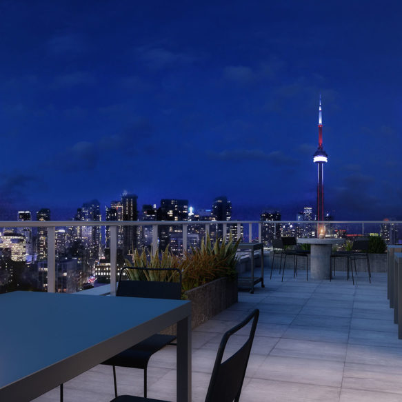 High-level outdoor space featuring patio furniture, candles and a view of the downtown Toronto skyline.