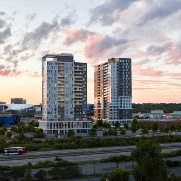 Sunset aerial view of Frontier and Latitude rental residences with an Ottawa highway in foreground.