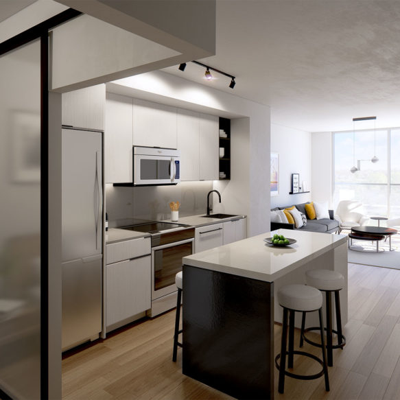 Suite kitchen with white finishes and a white and black kitchen island and a bright sunlit living room in the background.