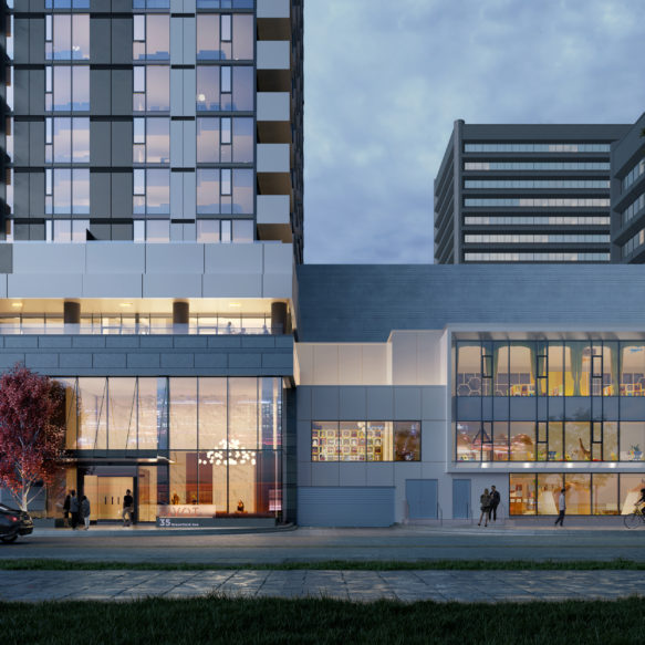 Evening street view of the Pivot rental residence podium and entrance featuring trees in trees and a busy street scene in the foreground.