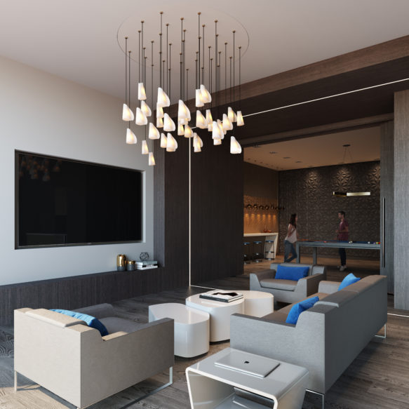 In a grey and white room, modern grey furniture with blue accents is arranged in front of a large television set into the wall.