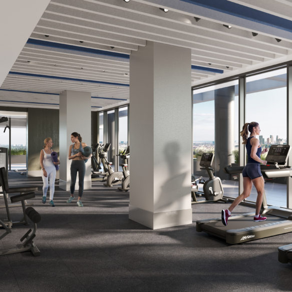Fitness centre with floor-to-ceiling windows, treadmills, stationary bikes and weight machines.