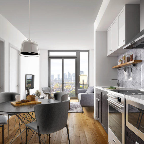 Suite interior featuring white and grey kitchen and downtown Toronto skyline view.