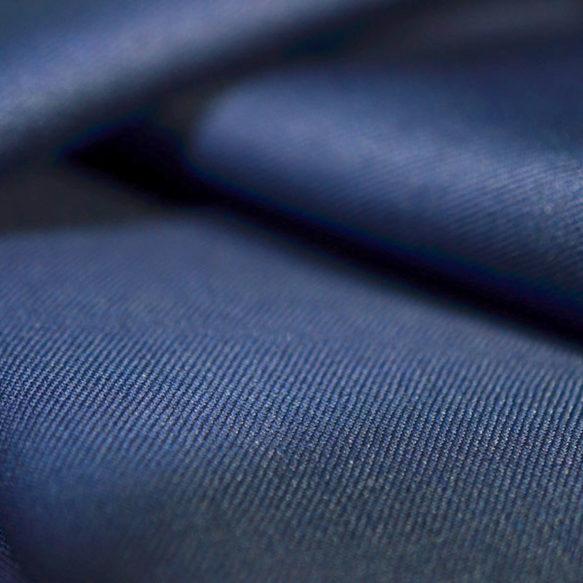 Waves of dark blue fabric.