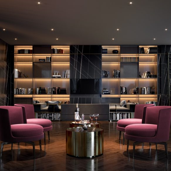 A luxurious lounge with a large bookcase, black marble walls and central purple seating features to the right, a grand piano.