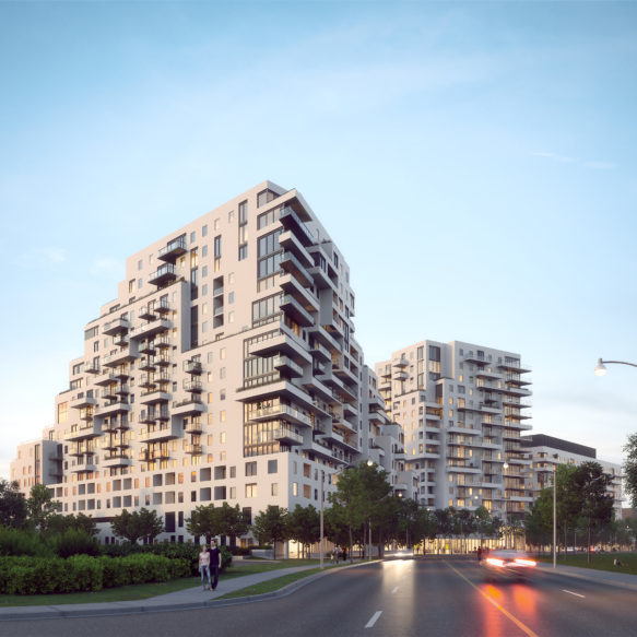 Evening street view of Queen & Ashbridge rental residences with green space in foreground.