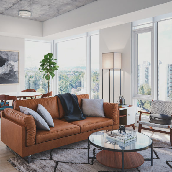 Living room with grey couch, bright large window and art on the wall