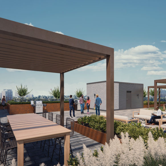 Rooftop terrace with a large communal table and some plush sitting areas