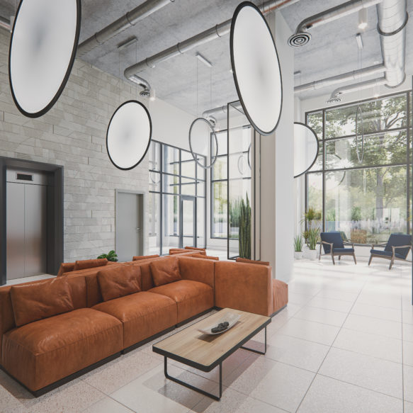 Lobby of Luma with a cozy brown leather couch and decorative lighting